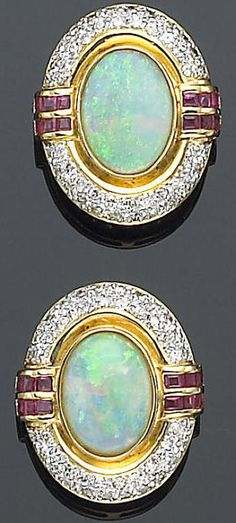 A pair of earrings of ruby, opal, diamond and fourteen karat gold jewelry.