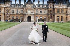 Happy Bride and Groom walking in Waddesdon Manor Gardens