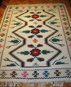Beautiful antique traditional Romanian hand woven wool carpet / rug with both floral and geometrical pattern.Available at www.greatblouses.com