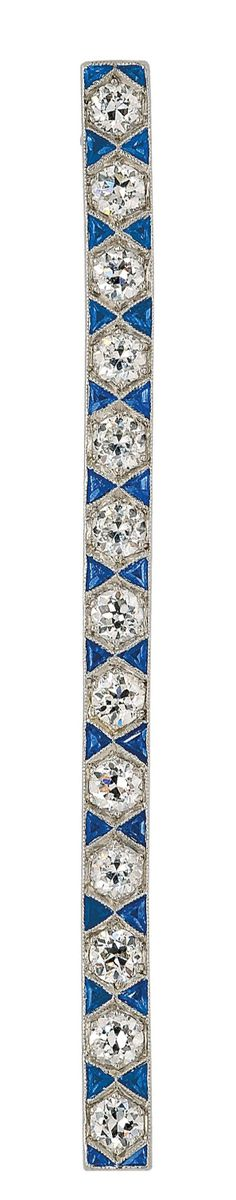 An Art Deco Diamond and Sapphire Bar Brooch, circa 1920  The slender bar designed with a series of round diamonds alternating with small sapphires set in a decorative hourglass pattern, mounted in platinum