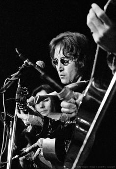 John Lennon and Yoko Ono performing at the John Sinclair Freedom Rally on December 10, 1971, at Crisler Arena in Ann Arbor, Michigan. (Photo by Leni Sinclair/Getty Images)