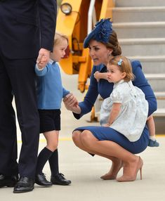 Kate Middleton Photos Photos - (L-R) Catherine, Duchess of Cambridge speaks to Prince George of Cambridge while holding Princess Charlotte of Cambridge as they arrive at Victoria International Airport on September 24, 2016 in Victoria, Canada. - 2016 Royal Tour to Canada of the Duke and Duchess of Cambridge - Victoria, British Columbia