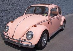 vintage pink VW  Pink used to be a male colour and then it became a female color and now it is flowing everywhere so we are all moving into pink peace for the futures.