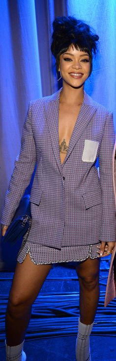 Rihanna gave this Spring '15 Dior suit a plunging neckline, showing off her tattoos!