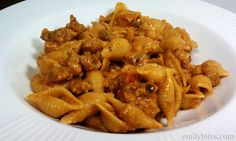 Cheesy Taco Pasta (for simply filling days must count the cheese points) Ingredients: 8 oz wheat pasta (I used Barilla medium shells) 1 lb 95% lean ground beef 1 oz packet reduced sodium taco seasoning 1 ½ c chunky salsa ½ c water ¼ c fat free sour cream ¾ c shredded 2 % reduced fat cheddar cheese ¾ c shredded sharp cheddar cheese (I used extra sharp) Salt & pepper to taste