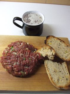 Tartar beef = raw beef with, raw egg, onion, herbs&spices, served with bread and beer