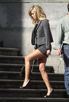 Reese Witherspoon has great legs wearing a short skirt suit and Louboutin high heels