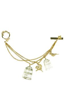 A delicate charm bracelet is the perfect first step towards a no-sweat summer arm party
