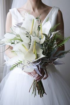 3 Wedding Flower Trends That Are On Right Now Wedding flowers are what makes a wedding feel festive and somewhat solemn, and choosing wedding florals is an indispensable part of wedding decor. Wedding Flower Guide, Floral Wedding, Wedding Flowers, Wedding Dresses, Blue Wedding, Calla Lily Wedding, Wedding Brooch Bouquets, Bride Bouquets, Flower Bouquets