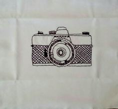 Hand-Embroidered camera
