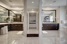 Contemporary Master Bathroom with Custom bathroom mirrors, Flush, Freestanding, Limestone, European Cabinets, High ceiling