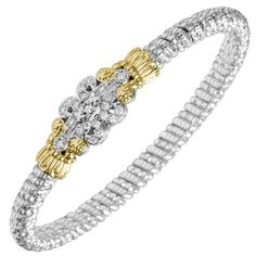 Scrollwork Bangle Bracelet Featuring 0.25 Carat Round Pave Diamonds in Sterling Silver & 14K Yellow Gold by Designer Vahan. Avaiable at BenGarelick.com $2875  https://www.bengarelick.com/products/vahan-sterling-silver-14k-yellow-gold-diamond-scrollwork-bangle-bracelet