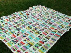"""Scrap """"coin quilt,"""" pattern .. I love the white stripes that break up the colors."""