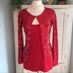 Moda International red sequins   cardigan  Who needs a Stunning outfit?  This is a simply stunning sweater cardigan. By Mode International. Size small but it's big so fits 6/8!! Very stretchy sweater.   Very warm and soft.   This is in excellent condition. Maybe 3 little sequins  loss that I can see.   Retail $70  Bought on Posh and love it, just a little big  my loss your gain. So beautiful. Moda International Sweaters Cardigans