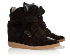 Inspiración sporty: los sneakers más chic para un look urbano Sneaker wedges en negro, de Isabel Marant.