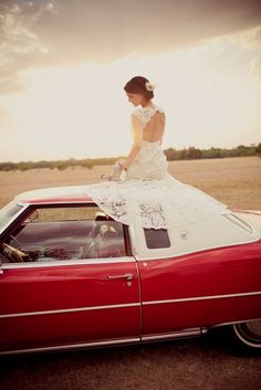 I my friends, will have a picture of me in my lacey wedding dress on an old car.