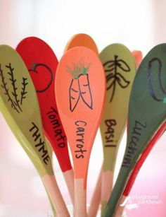 These colorful garden markers can be made with little more than wooden kitchen spoons, acrylic paint... - Courtesy of Playground Parkbench