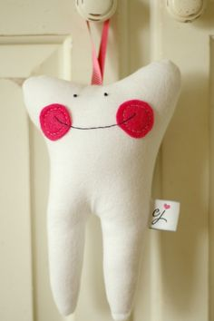 Tooth Fairy Pillow, would be easy to make. I like the idea of putting this on the door, easier to remember to put the $$ and less risk getting caught! Good for a light sleeper too.