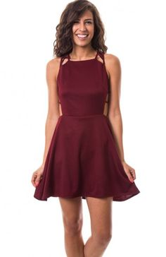 Square neck sleeveless skater dress featuring side cutouts, felt string back, and zipper back close. Perfect first date dress!  $12.95