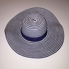 Floppy hat from forever 21 Navy and white stripe floppy hat perfect for the brash! Has a bow detail around the top piece! Forever 21 Accessories Hats