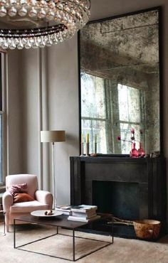 photo by ochre via chic provence ... modern vintage glam ... large mirror over mantle ... grey black pink