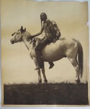 """VINTAGE PHOTOGRAPH of YOUNG CHIEFTAIN INDIAN BLACKFEET Native American 14"""" x 17"""". [Name, date and photographer unknown. JE]"""