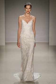 3d9241581f9 A model walks the runway at the Alfred Angelo Spring 2017 Bridal Show with  Disney Weddings at EZ Studios on October 2016 in New York City.