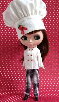 In one of the many costumes Garan has created for her, here's Blythe dressed up as a gourmet chef.