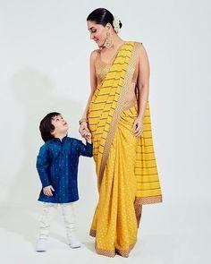 Kareena Kapoor looked graceful as ever in a bright yellow saree as she posed with son Taimur Ali Khan for Armaan Jain's wedding. Kajol Saree, Priyanka Chopra Wedding, Taimur Ali Khan, Yellow Saree, Gold Blouse, Kareena Kapoor Khan, Fashion Couple, New Fashion Trends, Saree Styles