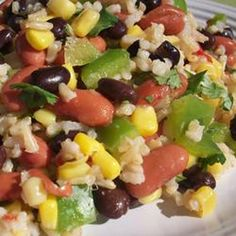 Mexican Bean and Rice Salad Recipe Salads with brown rice, kidney beans, black beans, whole kernel corn, drain, onion, green bell pepper, jalapeno chilies, lime, coriander leaf, minced garlic, ground cumin, salt