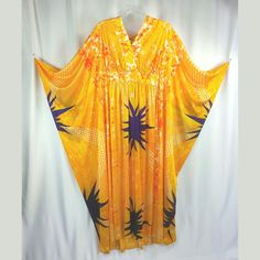 """70s Kaftan Dress Dress by Georgie Keyloun This is an amazing soft and silky polyester Kaftan dress with a vibrant print of yellow, white orange and red with large purple stars. The print has many different design elements going on including a print that looks like fish scales, a floral design and random spots of red tie dye among others. ♡ Flowy """"sleeves"""" ♡ Open bust Condition: Excellent vintage condition with no flaws that I can find. Measurements of dress in inches: Bust: Completely..."""
