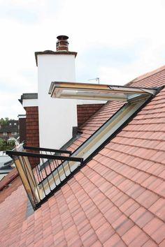 Skylight loft conversion London, with Velux balcony window
