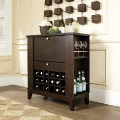 Adult beverages are a Thanksgiving celebration essential! The Espresso Bar Cabinet features plenty of space for both storing and serving your favorite cocktails and wines! The top hinges open and the front folds down for serving. Additional features include a drawer, side shelves and bottle storage.