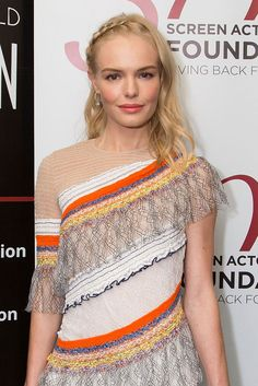 Kate Bosworth with a slim section of hair woven down the side with face framing waves