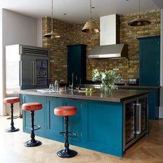 A gorgeous (and multi-tasking) island, exposed brick, cool bar stools...this kitchen ticks all the right boxes. Photographer: @paul_massey. Interior designer: @joberrymanstudio. #planetlivingetc