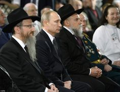 Putin sat with the Chief Rabbi of Russia Berl Lazar, left, and the Russian president of Jewish Communities Alexander Boroda, right, during the ceremony in Moscow