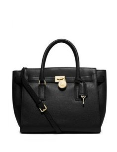 edb74a6d9b7f Buttery soft classic leather satchel bag with gleaming hardware. By MICHAEL  Michael Kors. Chic