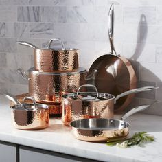 Create your dream copper kitchen with our Fleischer and Wolf Hammered Copper Cookware Set. This extraordinary copper cookware set shows off beautifully in the kitchen, featuring gleaming copper exteriors textured with artisanal-like hammering and elegant Copper Utensils, Copper Pans, Hammered Copper, Pure Copper, Copper Dishes, Copper Pot Set, Copper Cookware Set, Cast Iron Cookware, Crate And Barrel