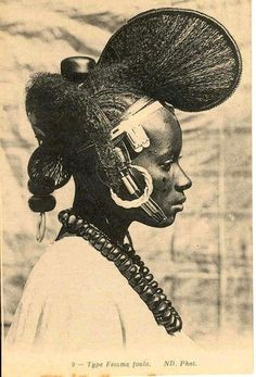 Vintage postcard, circa If my memory serves me right this is likely to be a Fulani woman, in French Guinea during the century. They were known for their elaborate hairstyles which resembled the wing of a butterfly } publisher & photographer unknown. African Tribes, African Women, African Art, African Diaspora, African Culture, African History, Traditional Hairstyle, Art Africain, We Are The World