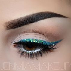 Aqua glitter eyeliner #cat #eye #makeup #glitter #makeup #eyeshadow #dramatic