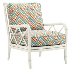 Bring an island-chic touch to your sunroom or master suite with this lovely rattan arm chair, featuring a bamboo-inspired frame and chevron-print cushions.