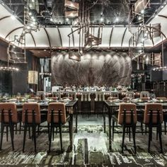 """Hong Kong museum restaurant by Joyce Wang  features """"spiral staircase"""" chandeliers"""