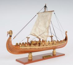 http://www.ebay.com/itm/Drakkar-Dragon-Viking-Ship-15-Wooden-Model-Sailboat-Nautical-Decor-/141055444152?pt=LH_DefaultDomain_0