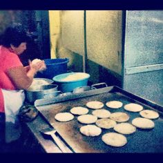 """Pupusas El Salvador.  These aren't """"our"""" ladies at La Magdalena, but the scene is very familiar - we eat a lot of those tasty pupusas!"""