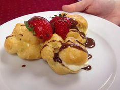 Now for pudding! Homemade profiteroles with fresh strawberries and warm chocolate sauce • Food by CGC Event Caterers • #wedding #caterers #food #dinner #Oakwell #Stadium #BarnsleyFC