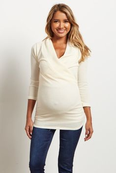 This cozy knit maternity top is perfect for all of motherhood's transitions. Whether you are pregnant or a brand new mommy, this top will keep you comfortable and stylish. A draped v-neckline makes it easy for nursing after pregnancy and accommodating a growing bump.