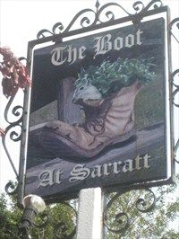 The Boot - Sarratt Green - Hertfordshire - A popular public house on the village green at Sarratt, Hertfordshire. The Boot was built in 1739 and today still retains many original, character features. With a warm and inviting ambience, exposed beams and brick built open fireplaces, The Boot offers a 'home from home' welcome with its traditional public bar area, large beer garden, children's play area, 22 seater restaurant and patio.