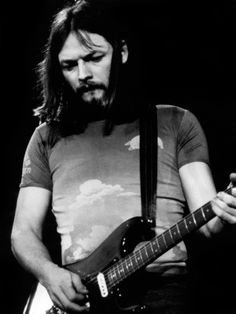 David Gilmour, Pink Floyd's guitarist. The one man that ever made want to pick up a guitar and learn to play. Never did though :(