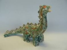 Afbeeldingsresultaat voor dinosaurus surprise Clay, Crown, Floral, Flowers, Animals, Jewelry, Clays, Corona, Animaux
