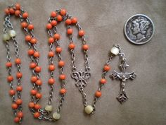 Precious Mediterranean natural sea coral and mother of pearl rosary. Coral was believed to have protective qualities and was extremely popular during the Victorian period.